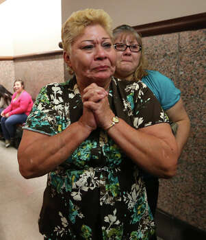 Gloria Herrera, left, and her daughter, Rosemary Camarillo, react after bond is set for the San Antonio Four at the Bexar County District Court 175th, Monday, Nov. 18, 2013. The actions cleared the way for the last three of four women sentenced for sexual assault of a child to be released from prison. Herrera is the mother of Elizabeth Ramirez who along with Cassandra Rivera, Elizabeth Ramirez, Kristie Mayhugh and Anna Vasquez was convicted in the 1994 case. Photo: Jerry Lara, San Antonio Express-News / ©2013 San Antonio Express-News