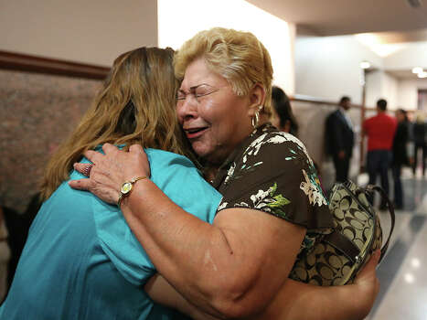 Gloria Herrera, right, hugs her daughter, Rosemary Camarillo, after bond is set for the San Antonio Four at the Bexar County District Court 175th, Monday, Nov. 18, 2013. The actions cleared the way for the last three of four women sentenced for sexual assault of a child to be released from prison. Herrera is the mother of Elizabeth Ramirez who along with Cassandra Rivera, Elizabeth Ramirez, Kristie Mayhugh and Anna Vasquez were convicted in the 1994 case. Photo: Jerry Lara, San Antonio Express-News / ©2013 San Antonio Express-News
