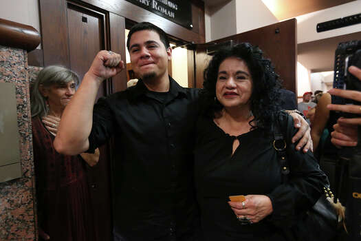 Margaret Rivera and her grandson, Mike Rivera celebrate after bond is set for the San Antonio Four at the Bexar County District Court 175th, Monday, Nov. 18, 2013. The actions cleared the way for the last three of four women sentenced for sexual assault of a child to be released from prison. Cassandra Rivera along with Elizabeth Ramirez, Kristie Mayhugh and Anna Vasquez were convicted in the 1994 case. Cassandra Rivera is the mother of Mike and daughter of Margaret. Photo: Jerry Lara, San Antonio Express-News / ©2013 San Antonio Express-News