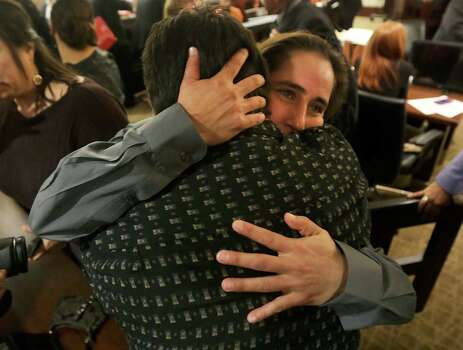 Anna Vasquez, right, embraces her brother David Vasquez, as family and friends of Elizabeth Ramirez, Cassandra Rivera and Kristie Mayhugh gather in the 175th District Court in the Cadena Reeves Justice Center to hear that the 3 women  will be released from prison. Monday, Nov. 18, 2013. The fourth women, Anna Vasquez, was released on parole from prison just over a year ago. Photo: Bob Owen, San Antonio Express-News / ©2013 San Antonio Express-News