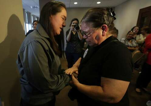 Maria Vasquez, right, says a prayer with her daughter Anna Vasquez, as family and friends of Elizabeth Ramirez, Cassandra Rivera and Kristie Mayhugh gather in the 175th District Court in the Cadena Reeves Justice Center to hear that the 3 women  will be released from prison. Monday, Nov. 18, 2013. The fourth women, Anna Vasquez, was released on parole from prison just over a year ago. Photo: Bob Owen, San Antonio Express-News / ©2013 San Antonio Express-News