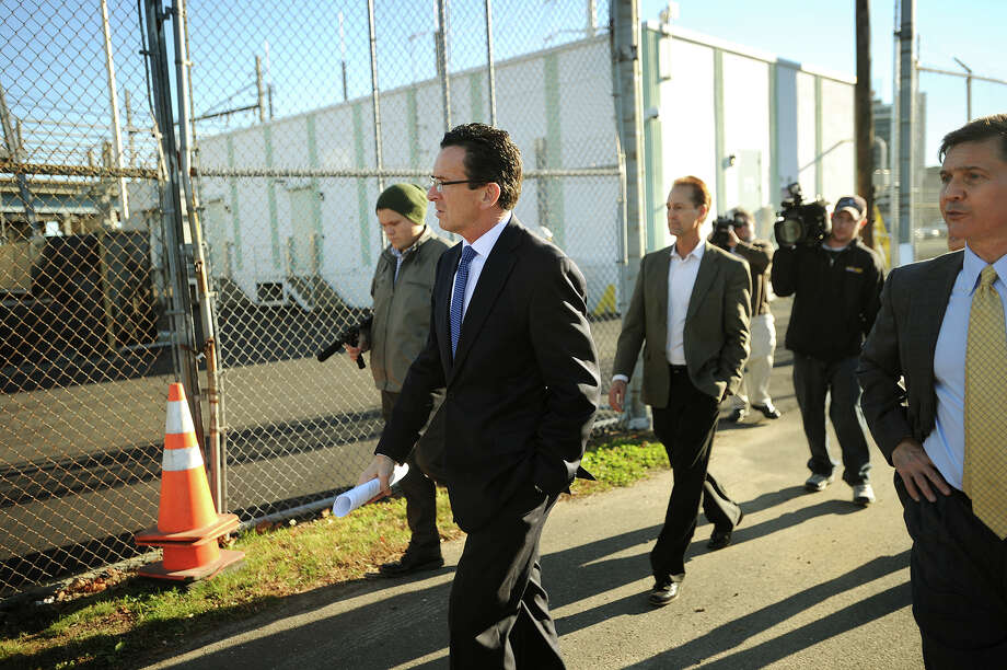 From left; Governor Dannel P. Malloy, COO of United Illuminating Electric John Prete, and state DEEP Commissioner Daniel C. Esty visit the newly upgraded Congress Street Substation in Bridgeport, Conn. on Monday, November 18, 2013. Improvements were made to protect the station from floodwaters like those that forced its closure during Superstorm Sandy. Photo: Brian A. Pounds / Connecticut Post