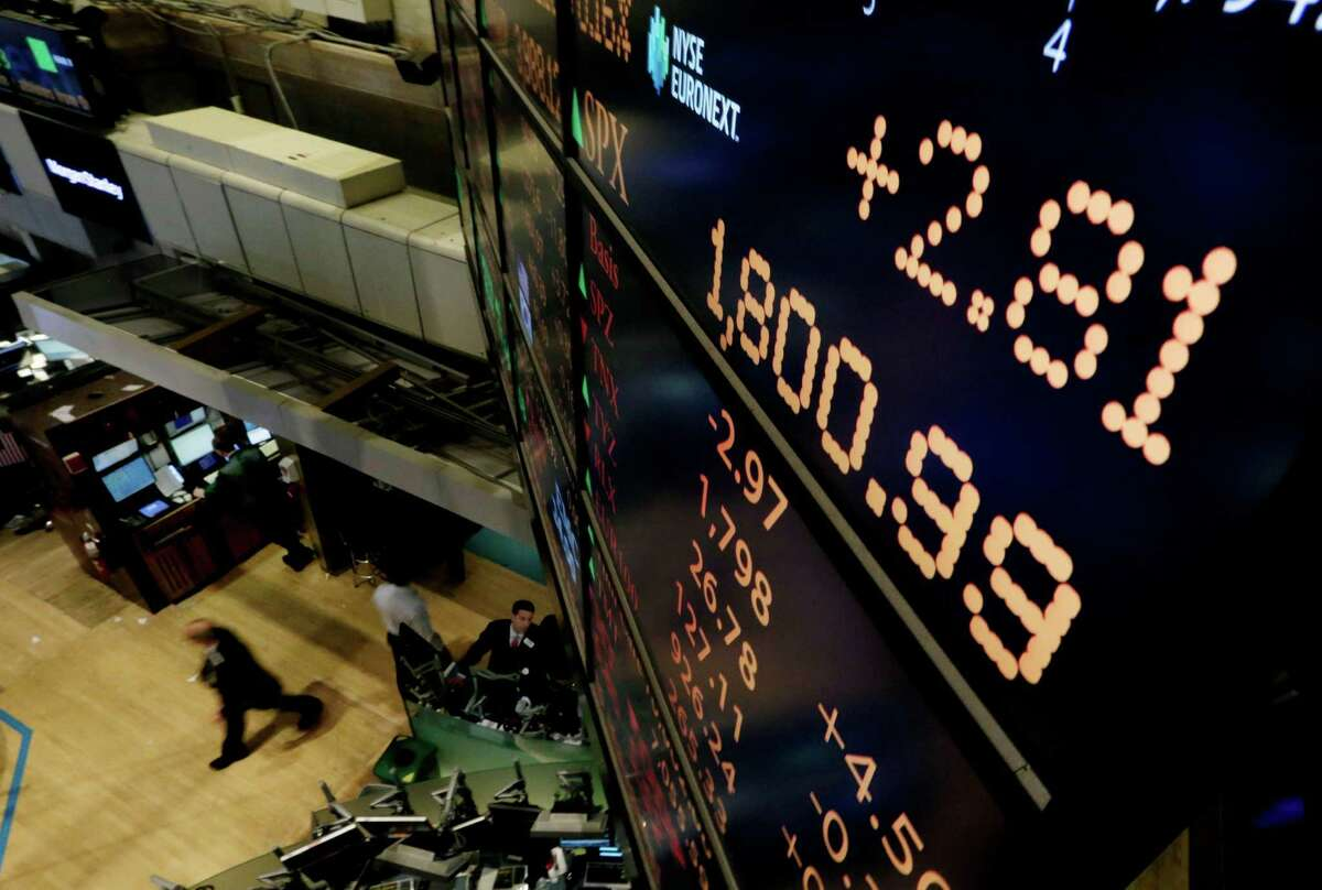 A board above the trading floor of the New York Stock Exchange shows the Standard & Poor's 500 index above 1,800, Monday, Nov. 18, 2013. The DJIA crossed 16,000 points for the first time early Monday and the Standard & Poor's 500 index crossed 1,800 points. (AP Photo/Richard Drew) ORG XMIT: NYRD113