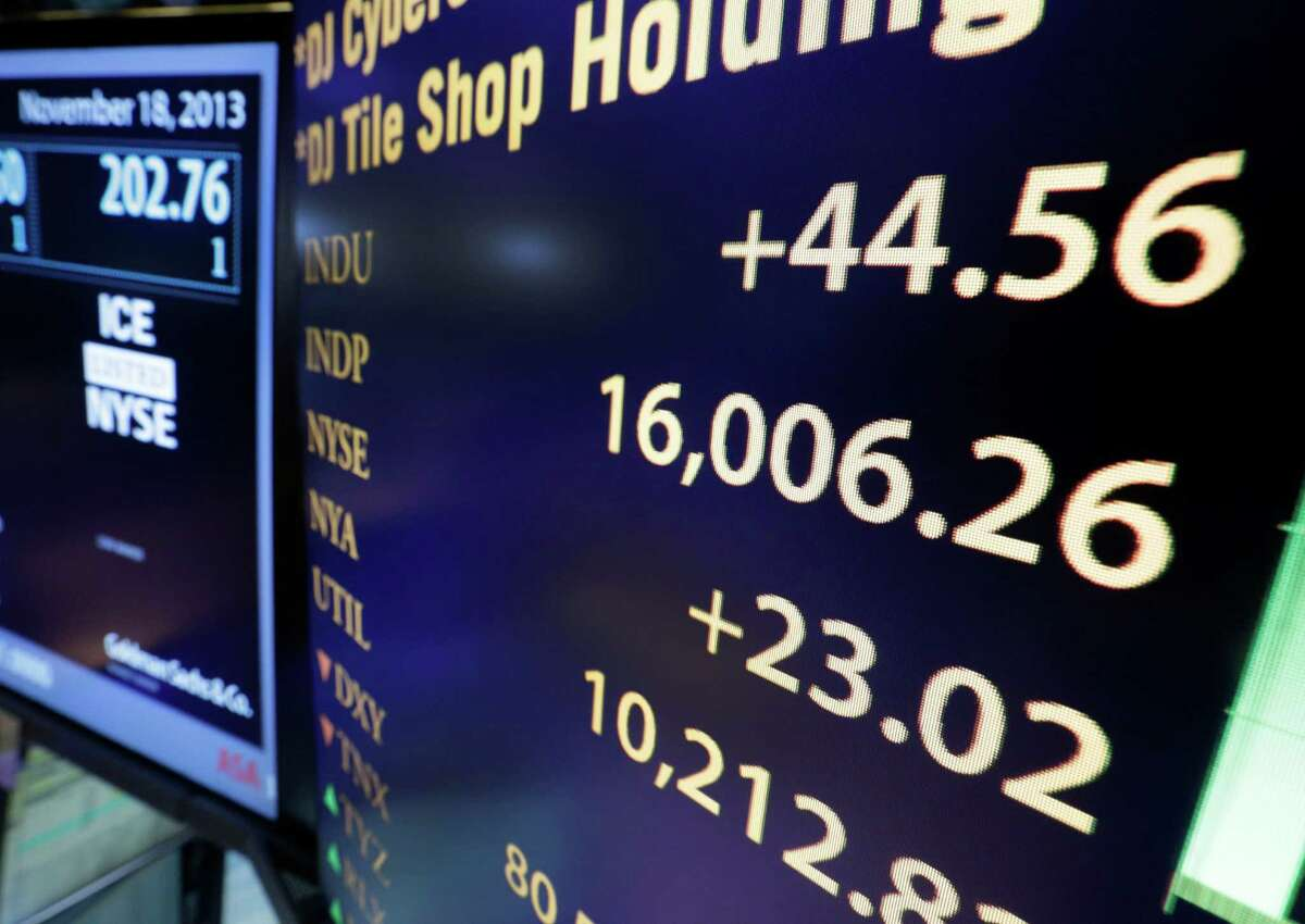 A board on the floor of the New York Stock Exchange shows the Dow Jones industrial average above 16,000, Monday, Nov. 18, 2013. The DJIA crossed 16,000 points for the first time early Monday and the Standard & Poor's 500 index crossed 1,800 points. (AP Photo/Richard Drew) ORG XMIT: NYRD101