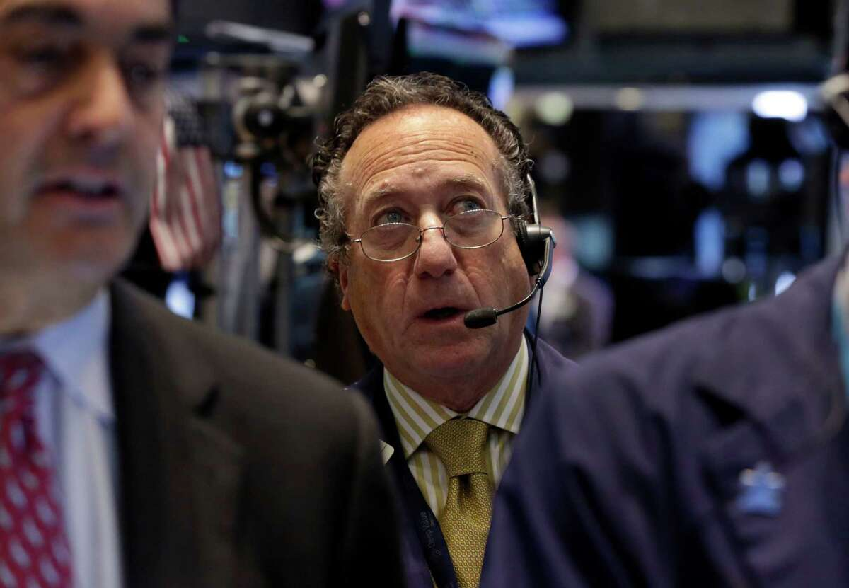 Trader Steven Kaplan, center, works on the floor of the New York Stock Exchange Monday, Nov. 18, 2013. The Dow Jones industrial average crossed 16,000 points for the first time early Monday and the Standard & Poor's 500 index crossed 1,800 points. (AP Photo/Richard Drew) ORG XMIT: NYRD112