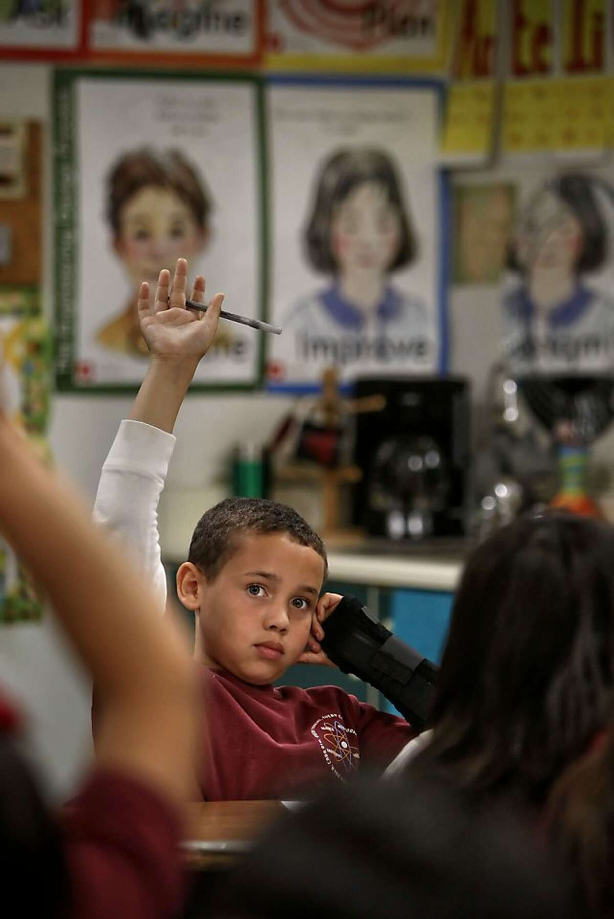Xander Carradine, at 3rd garder in Jennifer Benis' class is ready to answer a question at the Lazear Charter Academy in Oakland, Ca., on Tuesday Nov. 12, 2013. Lazear is among 40 charter schools throughout the City of Oakland. One school board member has decided to vote against allowing any new charter schools.