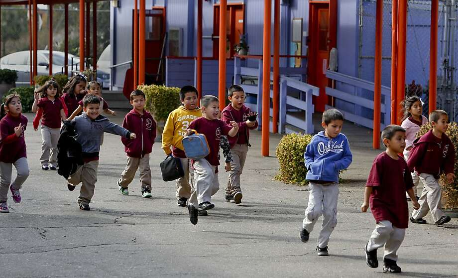 Students break for recess at Lazear Charter Academy in Oakland. Lazear, a public school that was closed by the school board last year, reopened as a charter campus after an appeal to the Alameda County Board of Education. Photo: Michael Macor, The Chronicle