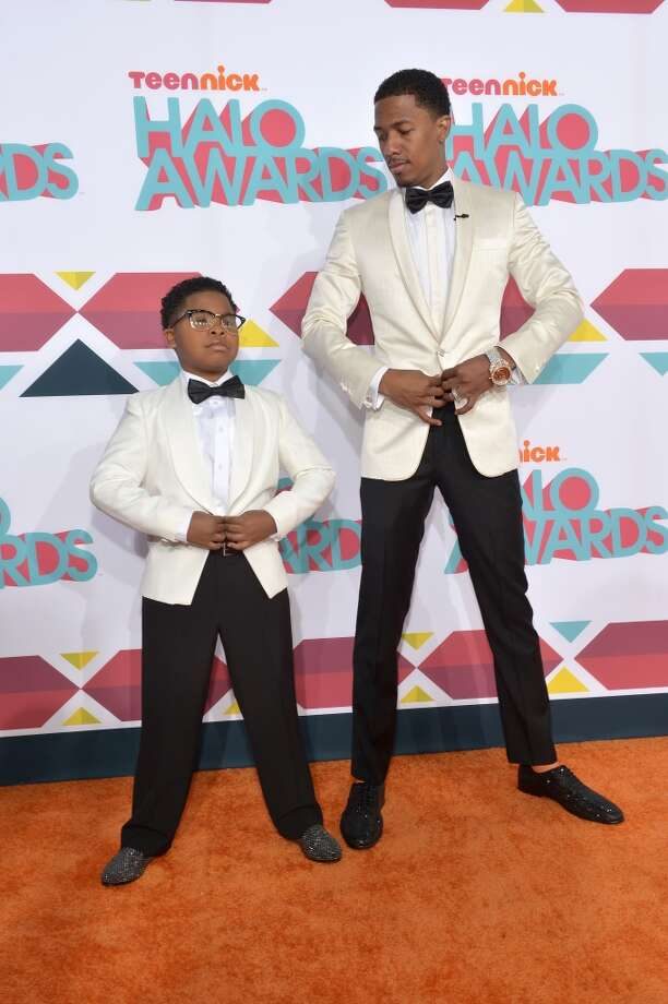 Actor Benjamin 'Lil P-Nut' Flores Jr. (L) and host Nick Cannon arrive at the 5th Annual TeenNick HALO Awards at Hollywood Palladium on November 17, 2013 in Hollywood, California. Photo: Charley Gallay, Getty Images For Nickelodeon