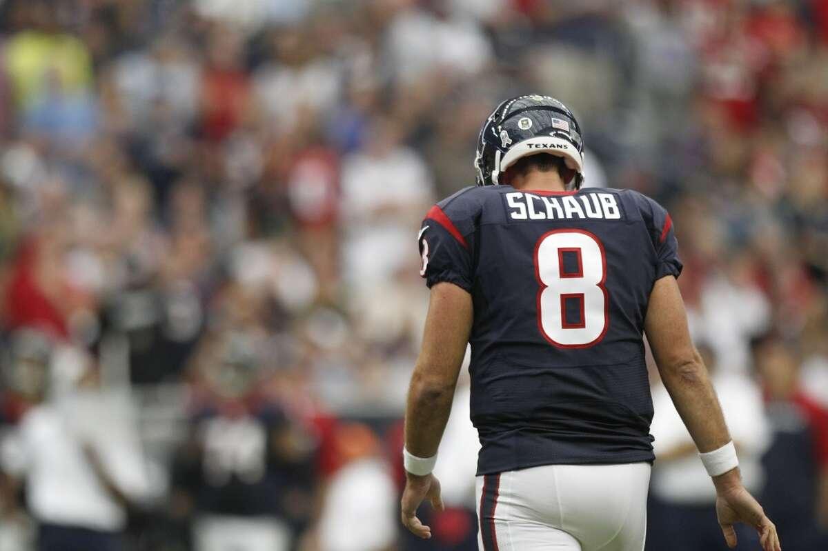 Texans quarterback Matt Schaub walks off the field after failing to convert on a fourth down play against the Raiders.