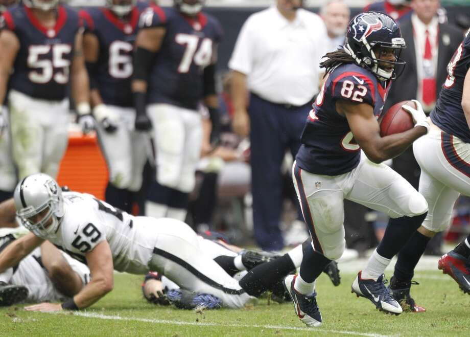 Texans wide receiver Keshawn Martin breaks away from Raiders long snapper Jon Condo on his way to an 87-yard punt return for a touchdown. Photo: Brett Coomer, Houston Chronicle