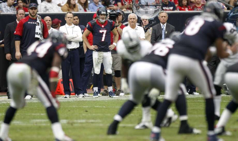 Texans quarterback Case Keenum stands on the sidelines after being taken out of the game in favor of Matt Schaub. Photo: Brett Coomer, Houston Chronicle