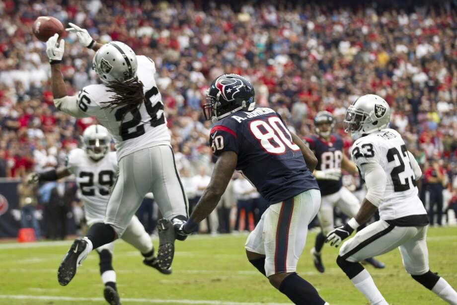 Raiders free safety Usama Young knocks down a pass in the end zone intended for Texans wide receiver Andre Johnson. Photo: Brett Coomer, Houston Chronicle