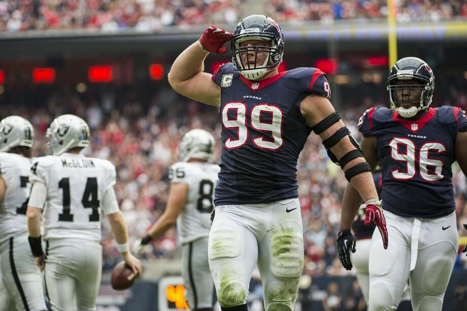 Texans defensive end J.J. Watt celebrates after sacking of Raiders quarterback Matthew McGloin. Photo: Smiley N. Pool, Houston Chronicle