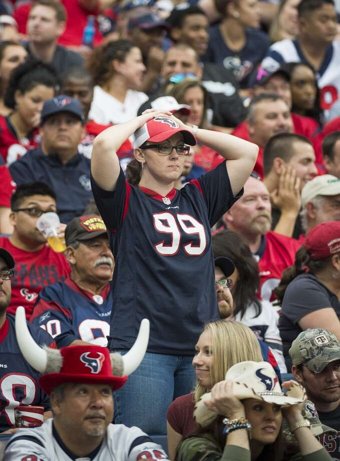Texans fans react after a 80-yard touchdown fun by Raiders running back Rashad Jennings. Photo: Smiley N. Pool, Houston Chronicle