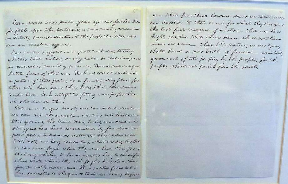 "In this Friday, Nov. 15, 2013 photo, Illinois' copy of the Gettysburg Address is seen on display at the Abraham Lincoln Presidential Museum and Library in Springfield, Ill. Illinois' copy of the manuscript, often called the ""Everett copy"" is the third of five known handwritten copies of the address. bears the distinction of being the only handwritten copy of the address to use the phrase ""under God"" which the Associated Press at the time reported Lincoln spoke at Gettysburg. (AP Photo/Seth Perlman) Photo: Seth Perlman, STF / AP"
