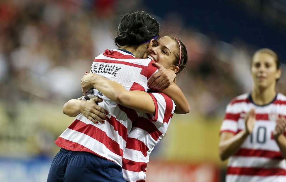 DETROIT, MI - DECEMBER 08:  Sydney Leroux #11 of Team USA celebrates with Alex Morgan #13 after scoring a second half goal during the game against China at Ford Field on December 8, 2012 in Detroit, Michigan. USA defeated China 2-0.  (Photo by Leon Halip/Getty Images) Photo: Getty Images
