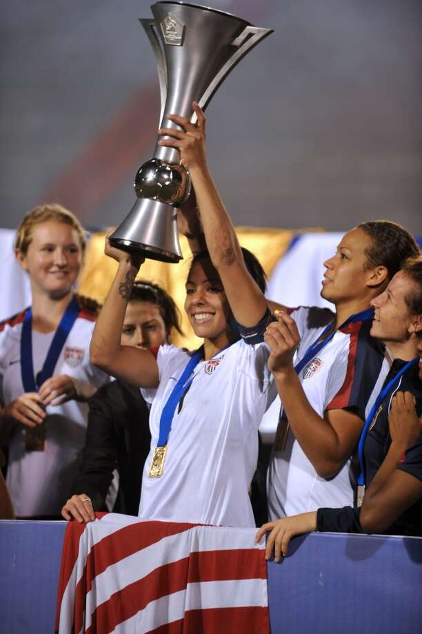 Sydney Leroux of the USA team lifts the trophy of CONCACAF champion after winning the Under 20 women final football match on January 30, 2010 in Guatemala City. AFP PHOTO / Johan ORDONEZ (Photo credit should read JOHAN ORDONEZ/AFP/Getty Images) Photo: AFP/Getty Images