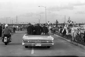 Presidential motorcade travels up Broadway toward the Gulf Freeway, Nov. 21, 1963.
