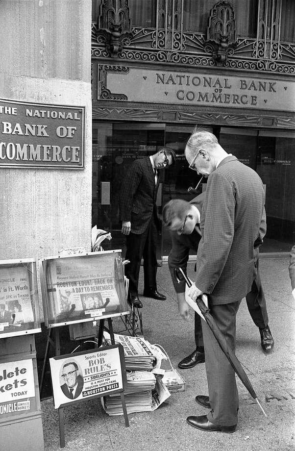 Downtown Houston pedestrians look at an extra edition of the Houston Press, Nov. 22, 1963. Photo: Houston Chronicle / Houston Chronicle
