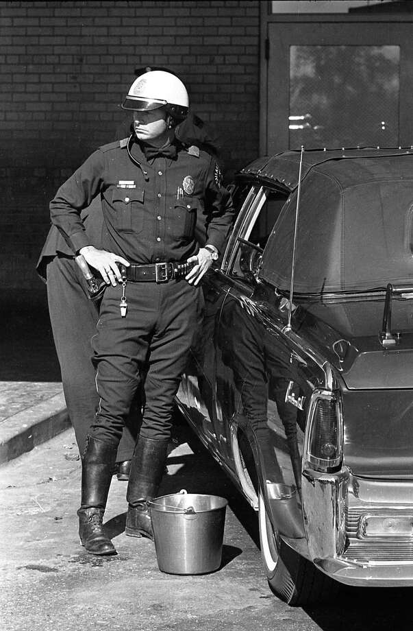 Dallas police officer outside Parkland Hospital, Nov. 22, 1963. Photo: Houston Chronicle / Houston Chronicle