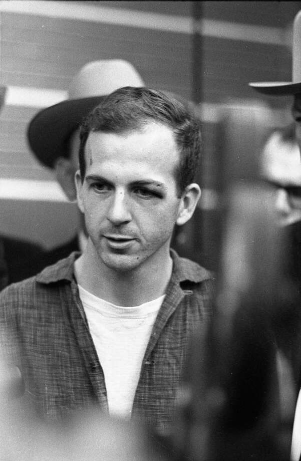 Lee Harvey Oswald at a news conference at the Dallas Police Department headquarters. Photo: Houston Chronicle / Houston Chronicle