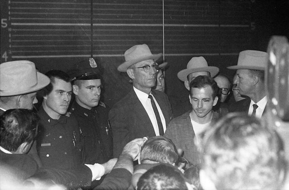 Lee Harvey Oswald and Dallas police officials at a news conference at Dallas Police Department headquarters. Photo: Houston Chronicle / Houston Chronicle