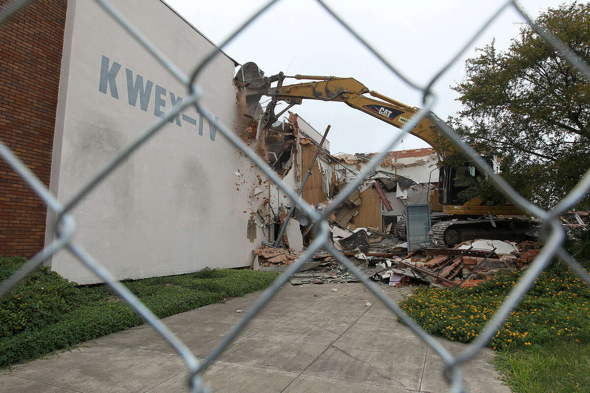 LEFT: Heavy equipment is used to demolish the former Univision building after a state district judge dissolved a temporary restraining order Nov. 12. RIGHT: Santiago Oropeza watches the former Univision building go down.