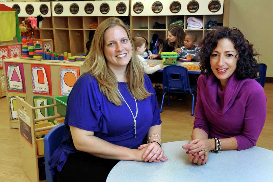 Lynn Rowland, 33, left, is the director and Kellie Mingachos, 44, is the owner of the Goddard School in Danbury, Conn., Friday, Nov. 15, 2013. Photo: Carol Kaliff / The News-Times