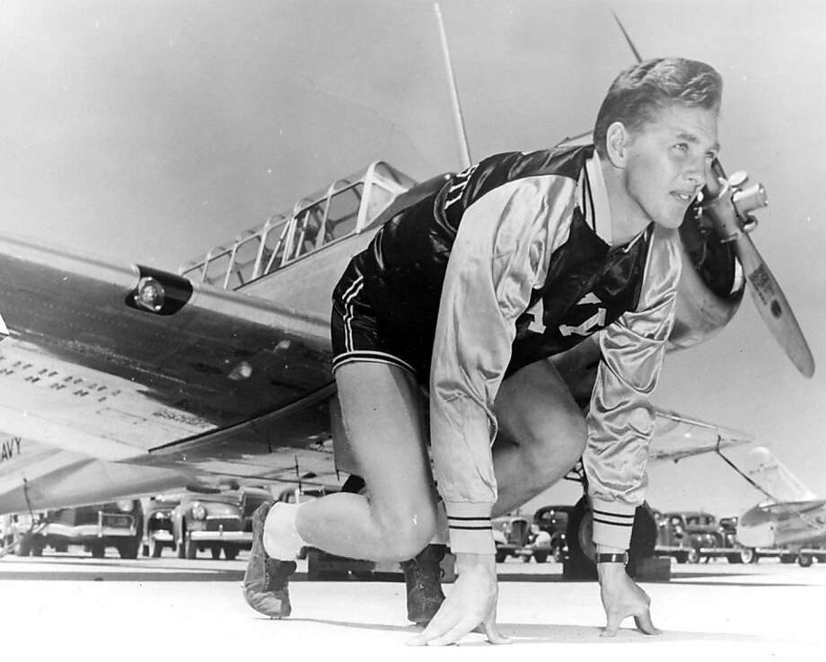 Kjell Qvale, a sprinter at the University of Washington, was a Navy pilot in World War II before becoming a car importer. Photo: The Kjell Qvale Collection