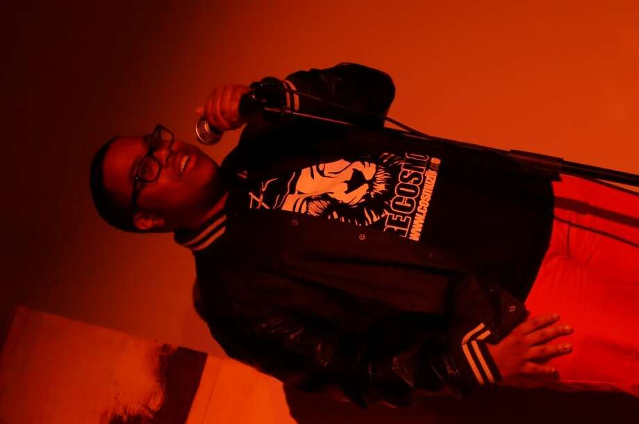 Poet/rapper Tre Cosmos did a spoken word piece before the night's music. Photo: Sketch The Journalist, 2013