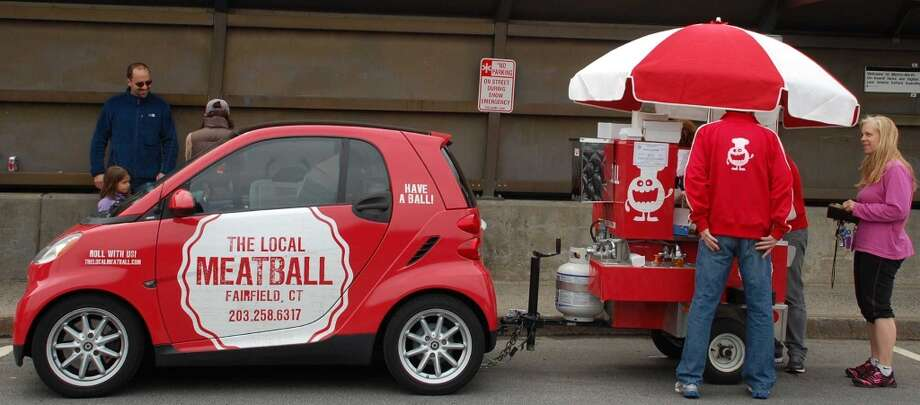 Even though the Local Meatball food cart is towed by a tiny Smart Car, its distinctive fire-red coloring makes it hard to miss on local streets. Photo: Jarret Liotta