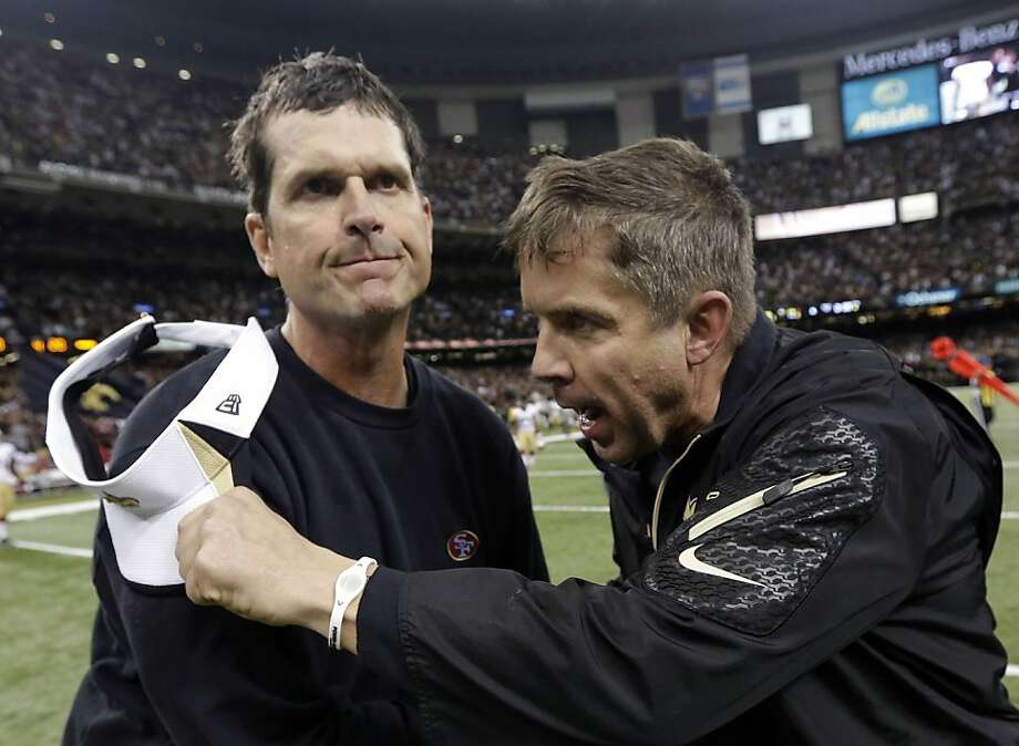 49ers head coach Jim Harbaugh is greeted by the Saints' Sean Payton after Sunday's loss in New Orleans. Photo: Dave Martin, Associated Press