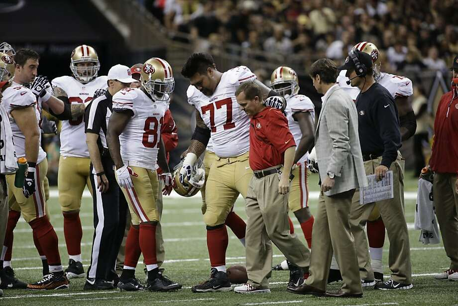 Mike Iupati (77) has a knee injury that could sideline him for some time. Photo: Dave Martin, Associated Press