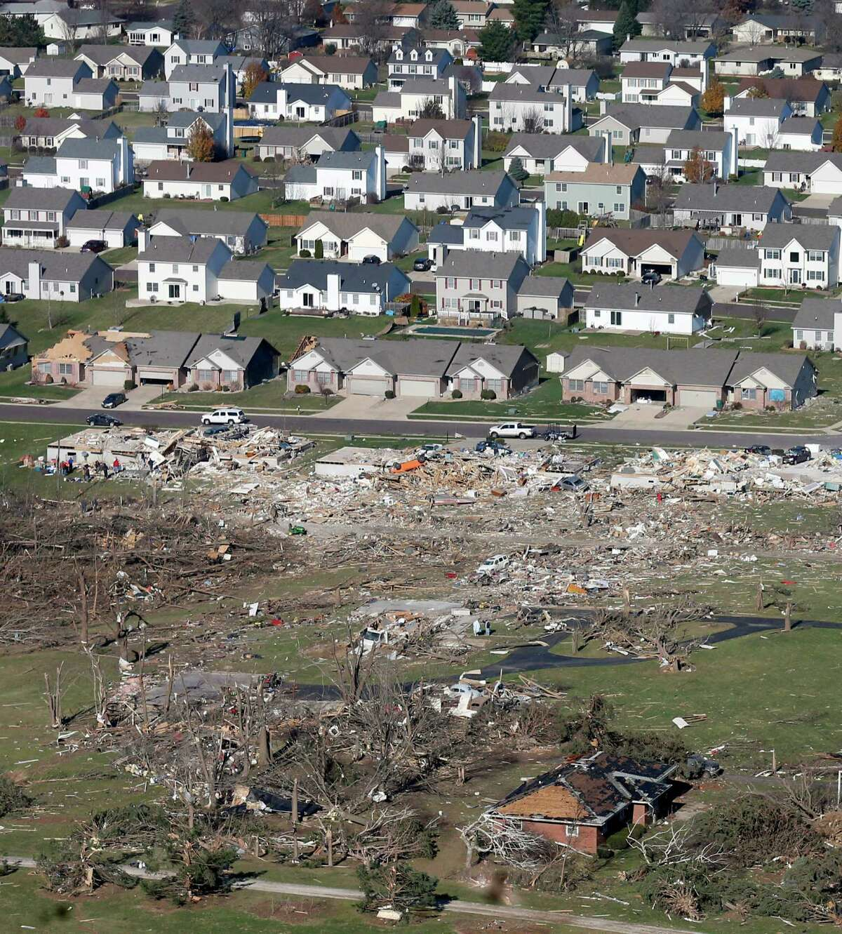 This aerial view on Monday, Nov. 18, 2013, shows untouched homes and homes destroyed by a tornado that hit the western Illinois town of Washington on Sunday. It was one of the worst-hit areas after intense storms and tornadoes swept through Illinois. The National Weather Service says the tornado that hit Washington had a preliminary rating of EF-4, meaning wind speeds of 170 mph to 190 mph. (AP Photo/Charles Rex Arbogast) ORG XMIT: ILCA105