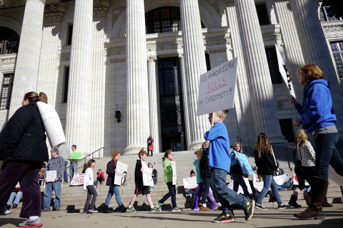 Parents and students take part in at an event outside the State Education building to protest the implementation of the Common Core set of educational standards in New York's schools on Monday, Nov. 18, 2013 in Albany, NY. (Paul Buckowski / Times Union)