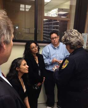 Bexar County Sheriff Susan Pamerleau talks to freed San Antonio Four before they leave the Bexar County Jail. Photo: Courtesy Photo / Bexar County Sheriff's Office