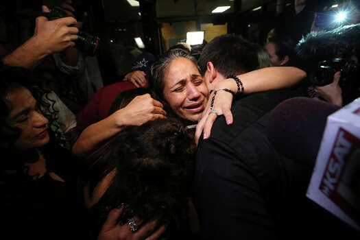 Cassandra Rivera, center, hugs her children, after she and the rest of the San Antonio Four are release at the Bexar County Jail, Monday, Nov. 18, 2013. A court ordered that the last three of the four be granted bail, clearing the way for for their release. They were serving time for sexual assault of a child case from 1994. Also released were Elizabeth Ramirez and Kristie Mayhugh. The fourth, Anna Vasquez, was paroled over a year ago. Photo: Jerry Lara, San Antonio Express-News / ©2013 San Antonio Express-News