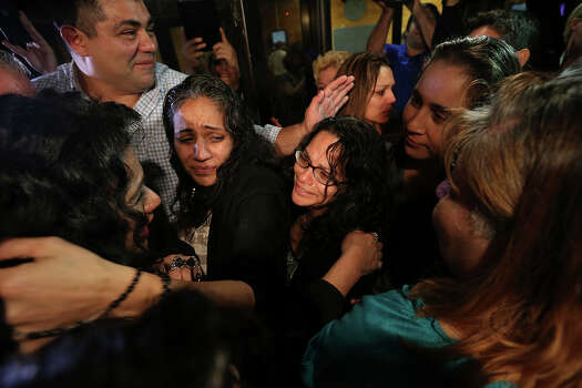 Families and friends surround the San Antonio Four after their release at the Bexar County Jail, Monday, Nov. 18, 2013. Center left is Cassandra Rivera and on the right is Elizabeth Ramirez. Kristie Mayhugh was also released. The fourth, Anna Vasquez was paroled over a year ago. The four women were convicted in a 1994 child sexual assault case. Photo: Jerry Lara, San Antonio Express-News / ©2013 San Antonio Express-News
