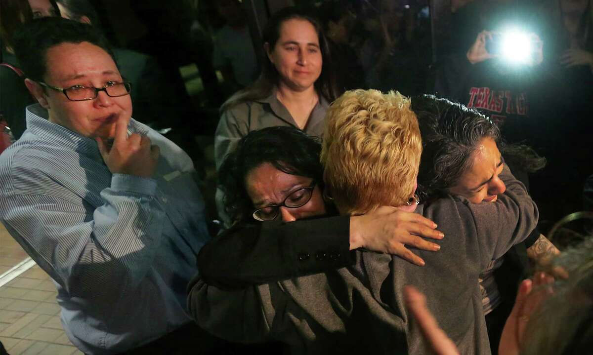 Cassandra Rivera, right, and Elizabeth Ramirez, are embraced by Gloria Herrera, Elizabeth's mother as Kristie Mayhugh, left, and Anna Vasquez, above exit Bexar Countly Jail. Rivera, Ramirez and Mayhugh were released from from prison today Monday, Nov. 18, 2013. Anna Vasque, was released on parole from prison just over a year ago.