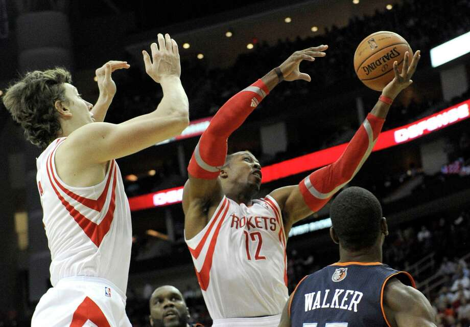 Dwight Howard, right, averages 14.2 rebounds in 35.7 minutes per game; Omer Asik, left, 7.2 in 20.7 mpg. Photo: Pat Sullivan, STF / AP