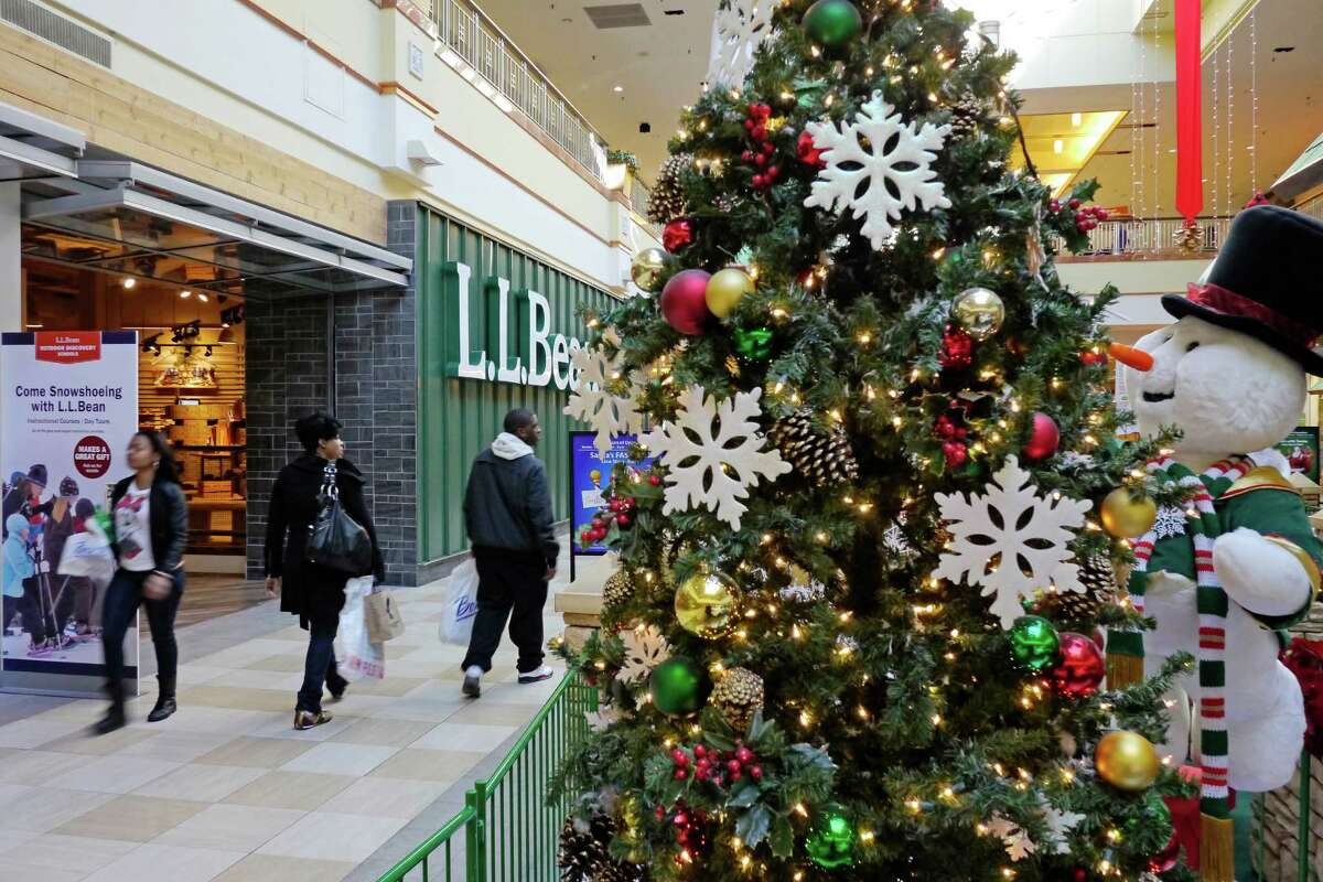 Shoppers make their way past the LL Bean store at Colonie Center mall on Monday, Nov. 18, 2013 in Albany, NY. Along with the anchor stores at the mall some of the smaller stores, like LL Bean, will also be opening on Thanksgiving this year to attract early shoppers. (Paul Buckowski / Times Union)