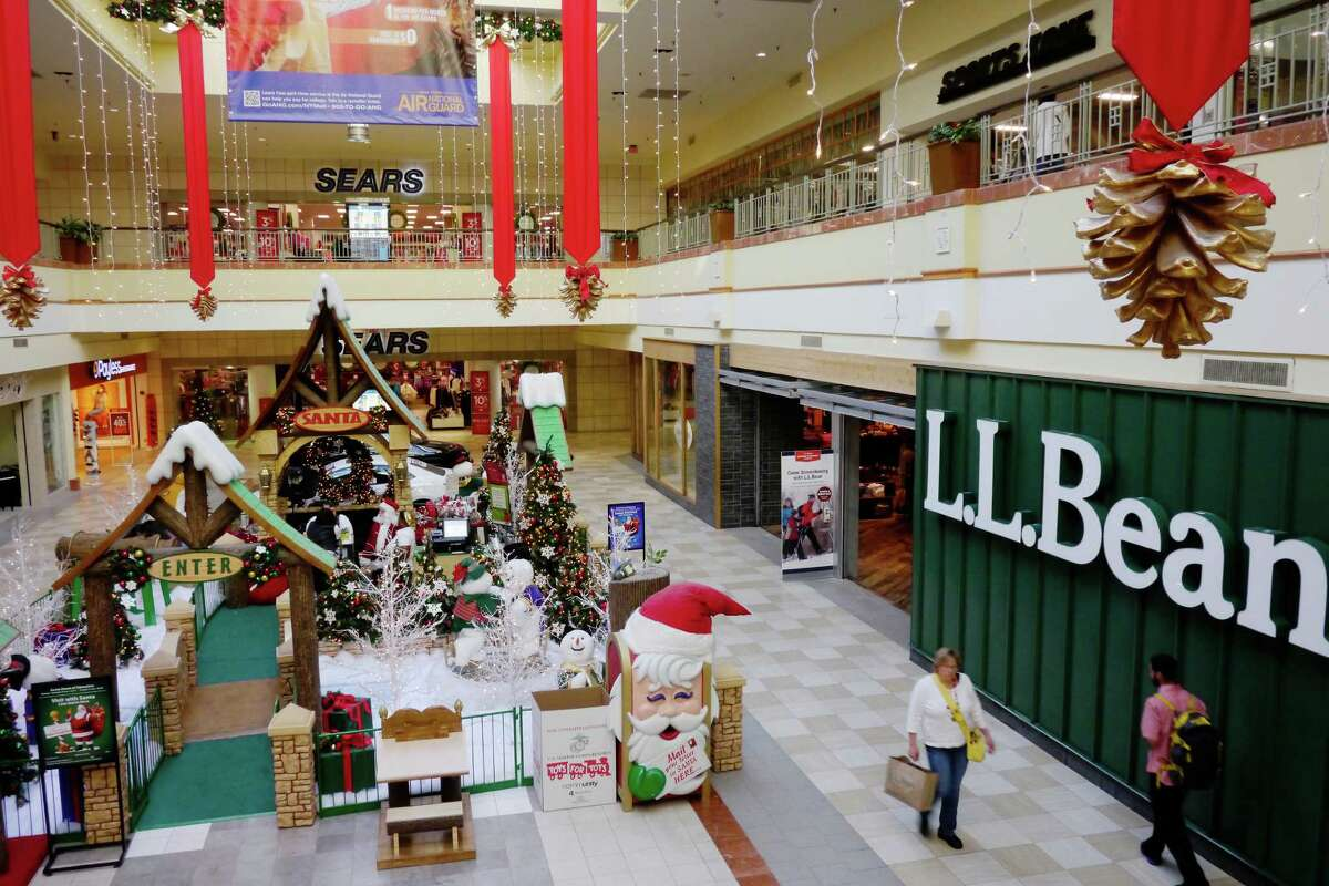 Shoppers make their way past the LL Bean store at Colonie Center mall on Monday, Nov. 18, 2013 in Albany, NY. Along with the anchor stores, at the mall, like Sears, some of the smaller stores, like LL Bean will also be opening on Thanksgiving this year to attract early shoppers. (Paul Buckowski / Times Union)