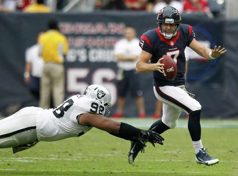 Case Keenum gets away from Raiders defensive tackle Daniel Muir during a first half in which he led the Texans to 10 points before the offense fizzled in the third quarter. Photo: Brett Coomer, Staff / © 2013  Houston Chronicle