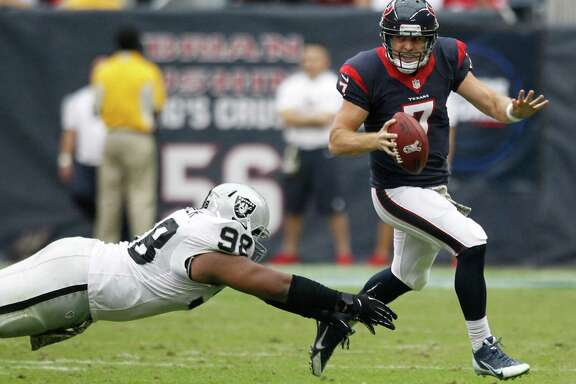Case Keenum gets away from Raiders defensive tackle Daniel Muir during a first half in which he led the Texans to 10 points before the offense fizzled in the third quarter.