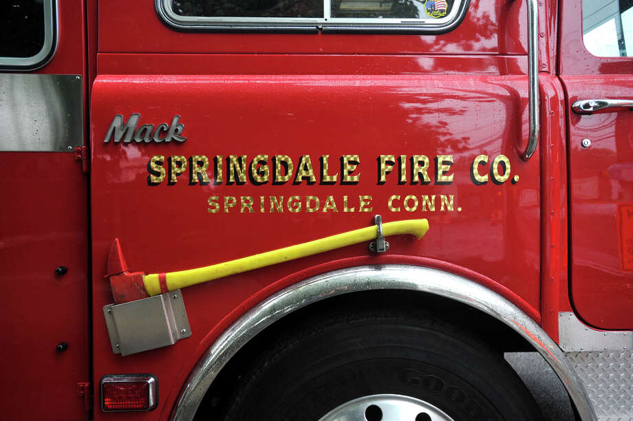 The Springdale fire station held its open house Sunday afternoon in Stamford, Conn., on Oct. 6, 2013. The open house featured, among other things, tours of the trucks the firefighters use, safety demonstrations with fake fire and smoke and firefighters taught the proper technique to using a fire hose. Photo: Jason Rearick / Stamford Advocate