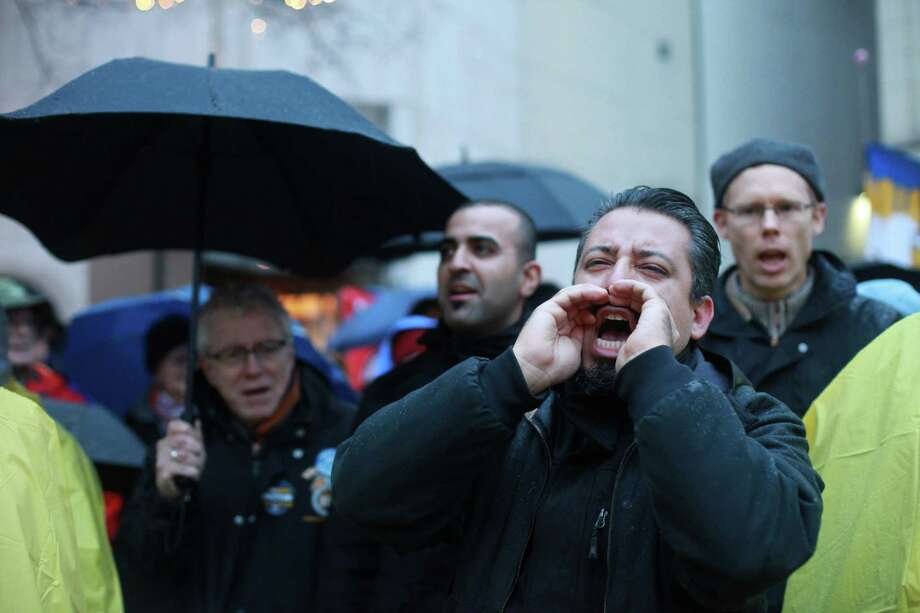 Pedro Olguin chants at the Community & Labor Rally at Westlake Park on Monday, Nov. 18, 2013. The rally was held to support union members that voted against a contract offered by Boeing. The decision by the Machinists Union may lead to Boeing building the 777X outside of Washington state. Photo: SOFIA JARAMILLO, SEATTLEPI.COM / SEATTLEPI.COM