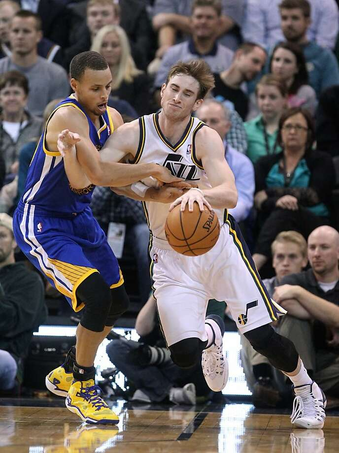 Stephen Curry's defense on Gordon Hayward gets a bit too tight, resulting in a foul call. Photo: Rick Bowmer, Associated Press