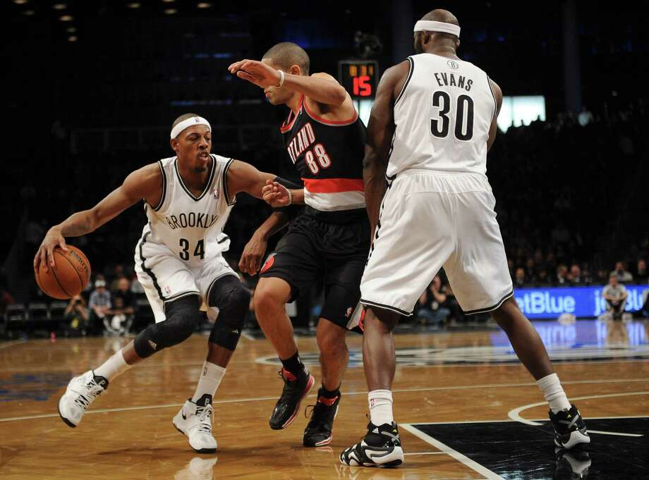 NEW YORK, NY - NOVEMBER 18:  Paul Pierce #34 of the Brooklyn Nets drives against Nicolas Batum #88 of the Portland Trail Blazers at Barclays Center on November 18, 2013 in the Brooklyn borough of New York City. The Trail Blazers defeat the Nets 108-98. NOTE TO USER: User expressly acknowledges and agrees that, by downloading and/or using this photograph, user is consenting to the terms and conditions of the Getty Images License Agreement.  (Photo by Maddie Meyer/Getty Images) ORG XMIT: 182407689 Photo: Maddie Meyer / 2013 Getty Images