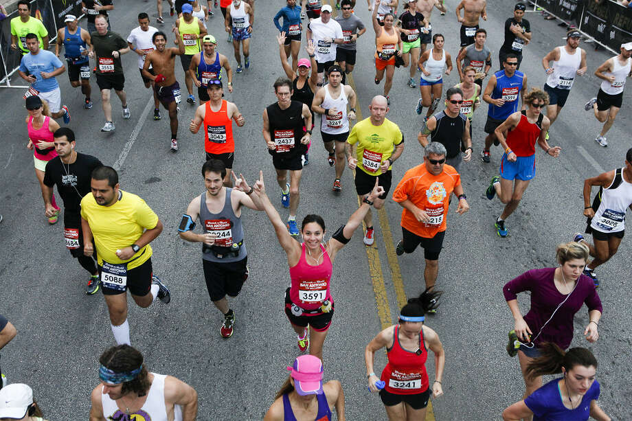 Hot weather during Sunday's race prompted officials to schedule the 2014 San Antonio Rock 'n' Roll Marathon for Dec. 7. Photo: Marvin Pfeiffer / San Antonio Express-News