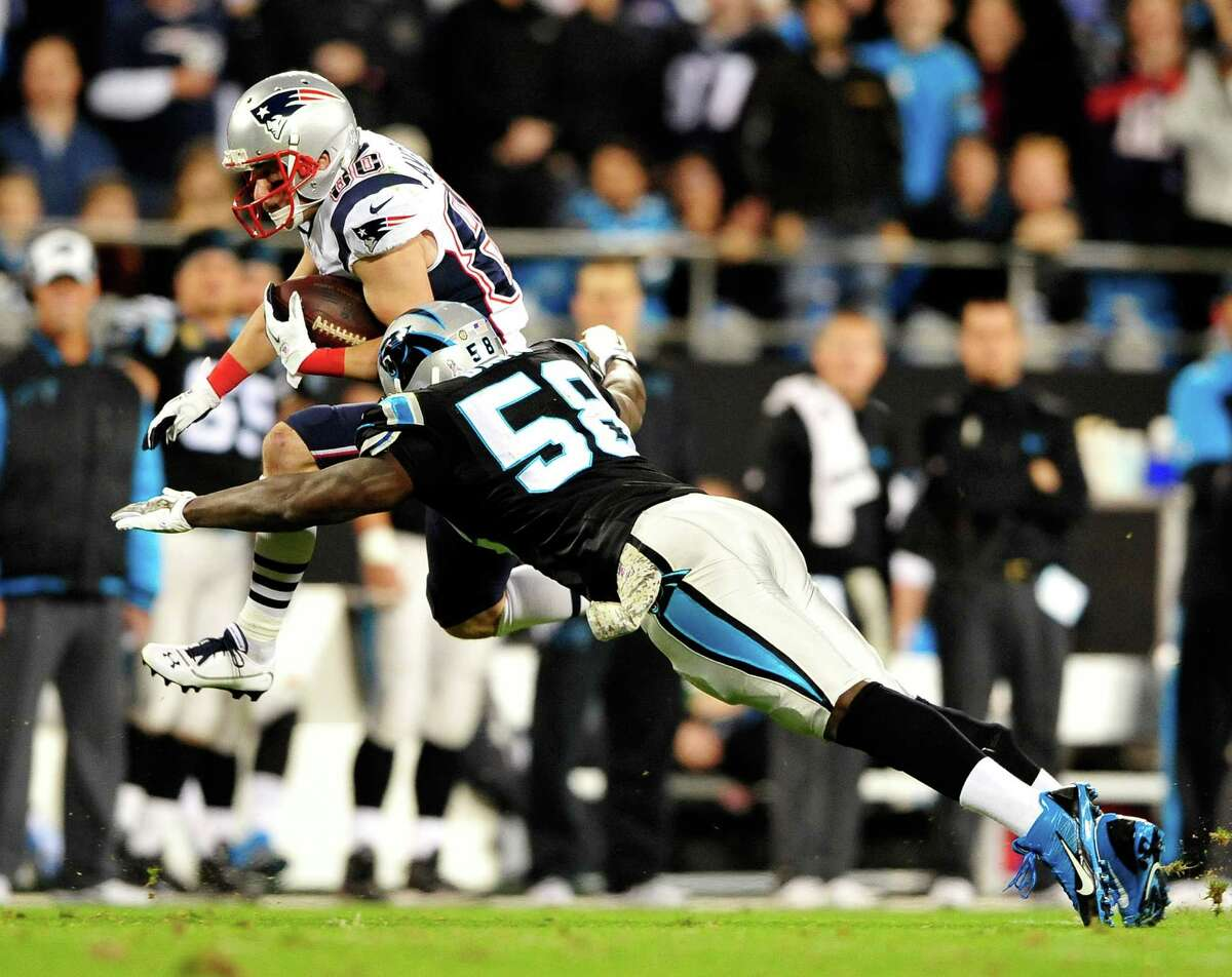 CHARLOTTE, NC - NOVEMBER 18: Danny Amendola #80 of the New England Patriots is tackled by Thomas Davis #58 of the Carolina Panthers during play at Bank of America Stadium on November 18, 2013 in Charlotte, North Carolina. (Photo by Grant Halverson/Getty Images) ORG XMIT: 184892950